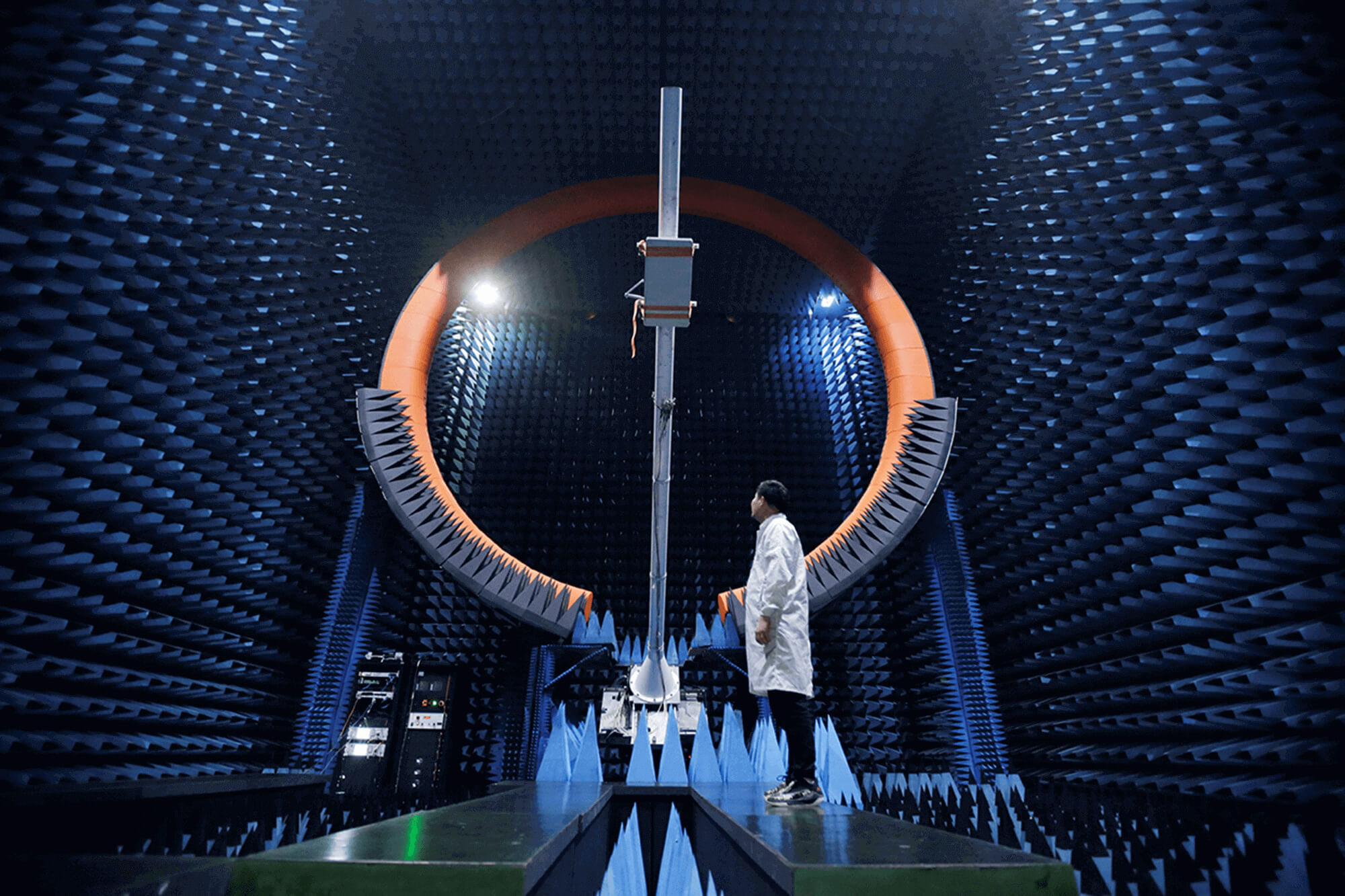 Engineer stands under a 5G antenna at a Huawei testing area in 2019. Huawei has received support as part of China's Digital Silk Road Initiative.