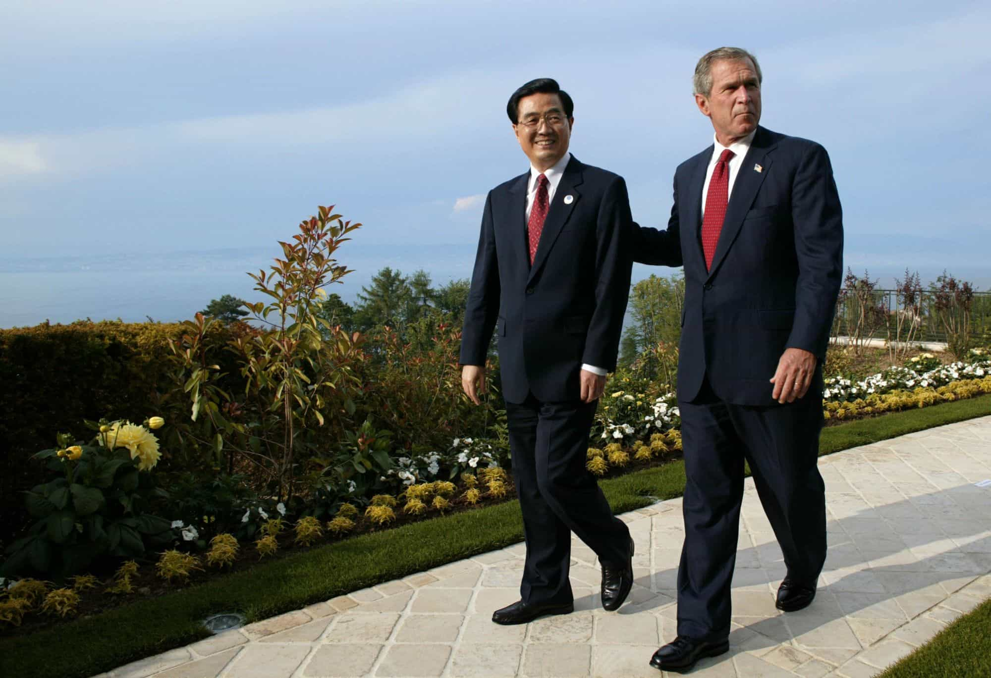 Chinese President Hu Jintao walks with U.S. President George W. Bush at a Group of Eight (G8) summit, in France, in 2003.