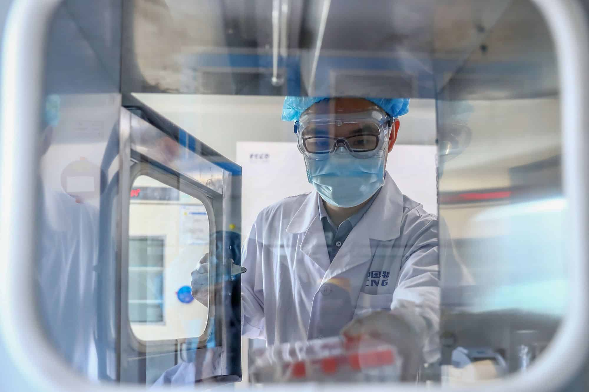 A staff member takes out samples of the COVID-19 inactivated vaccine at a vaccine production plant in Beijing, in April 2020.