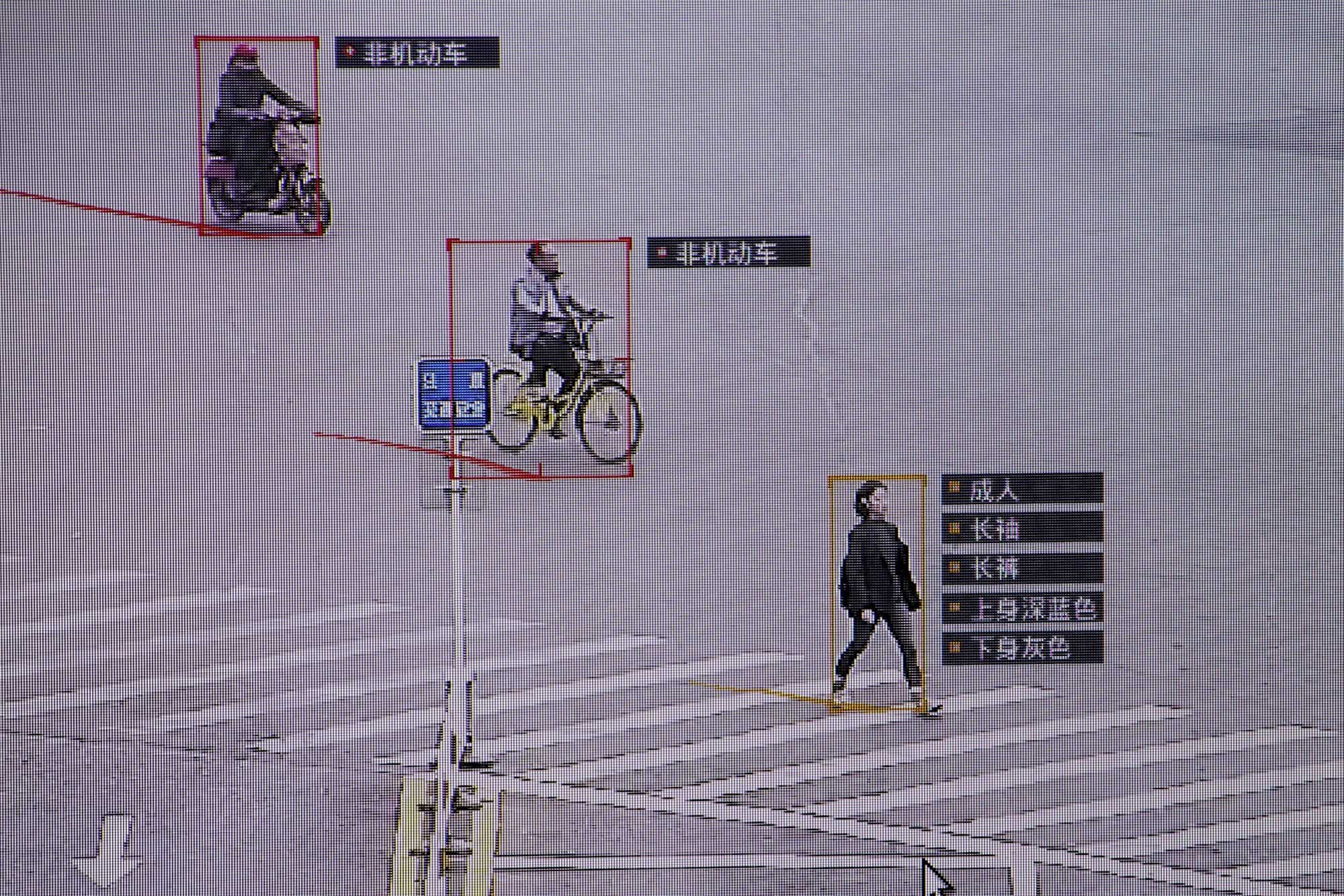 Surveillance software identifies details about people and vehicles crossing a street, in October 2017. Under Xi Jinping, China has built a massive domestic surveillance state and is beginning to export its brand of high-tech authoritarianism.