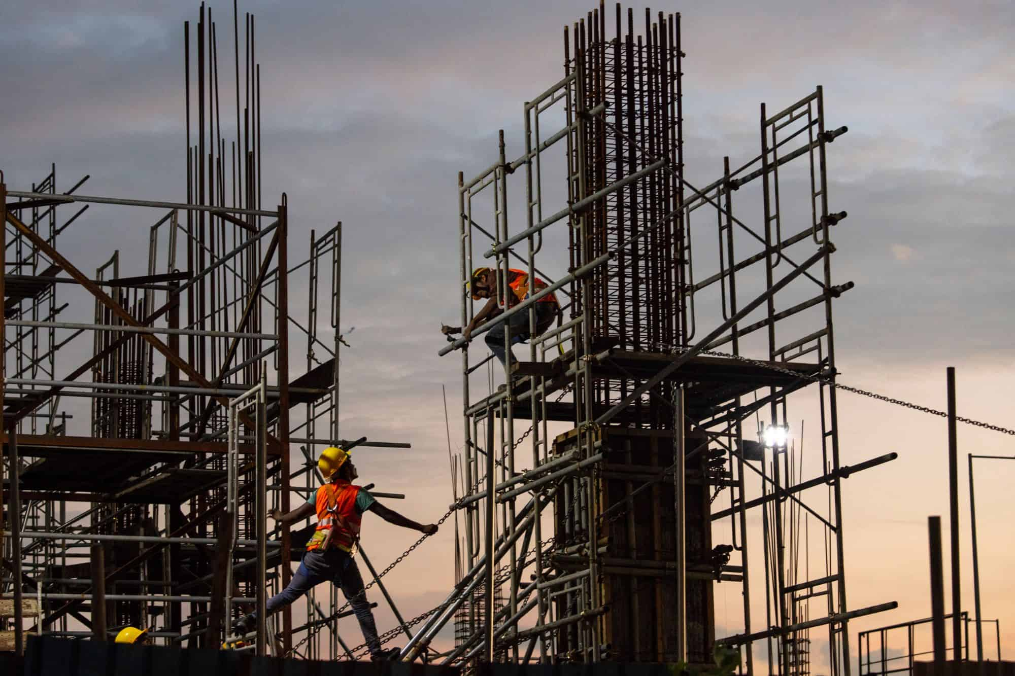 Construction workers in Sri Lanka head home after helping build a large China-backed shopping complex, in 2018.
