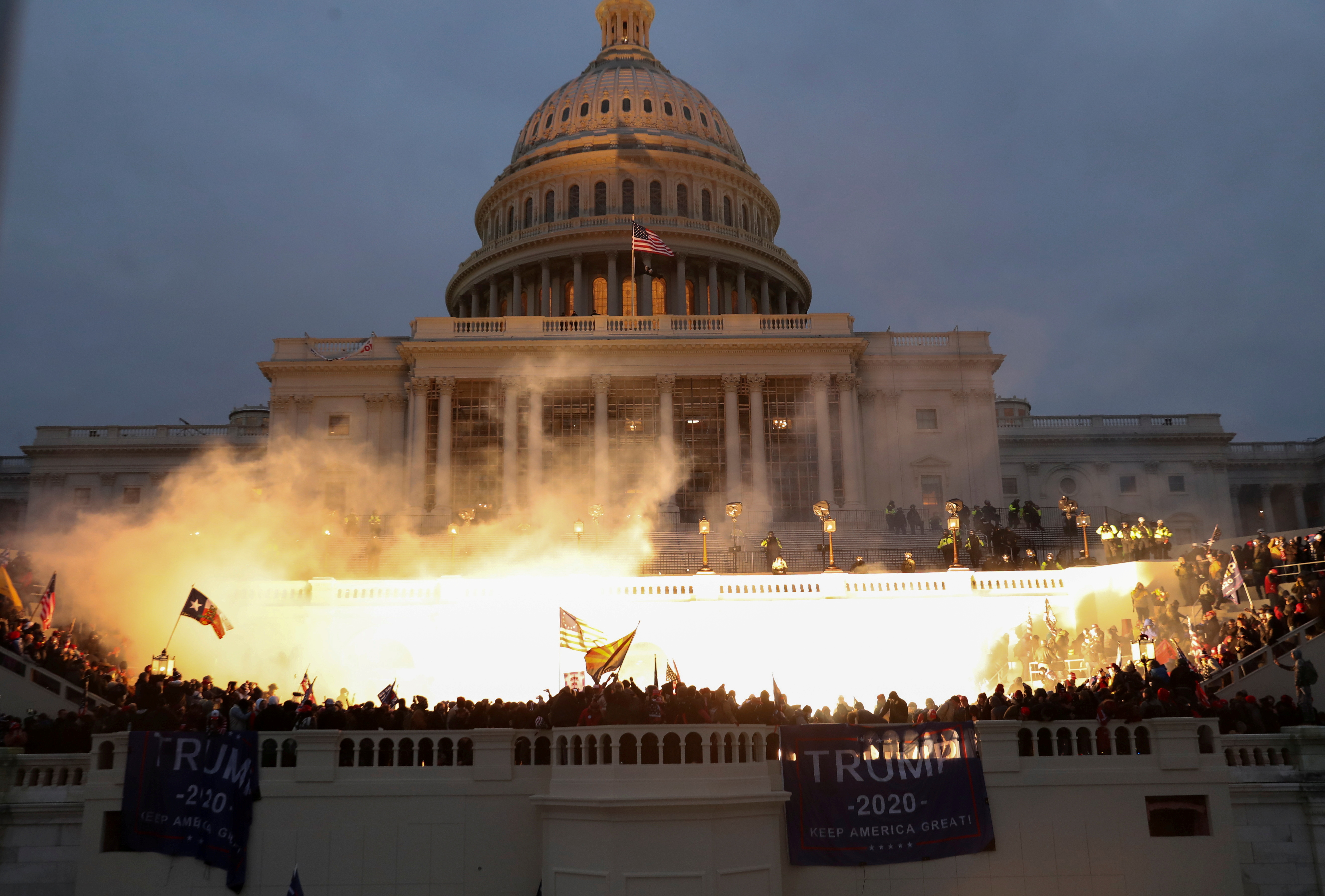 An explosion caused by a police munition is seen while supporters of U.S. President Donald Trump gather in front of the U.S. Capitol Building in Washington, DC, on January 6, 2021.