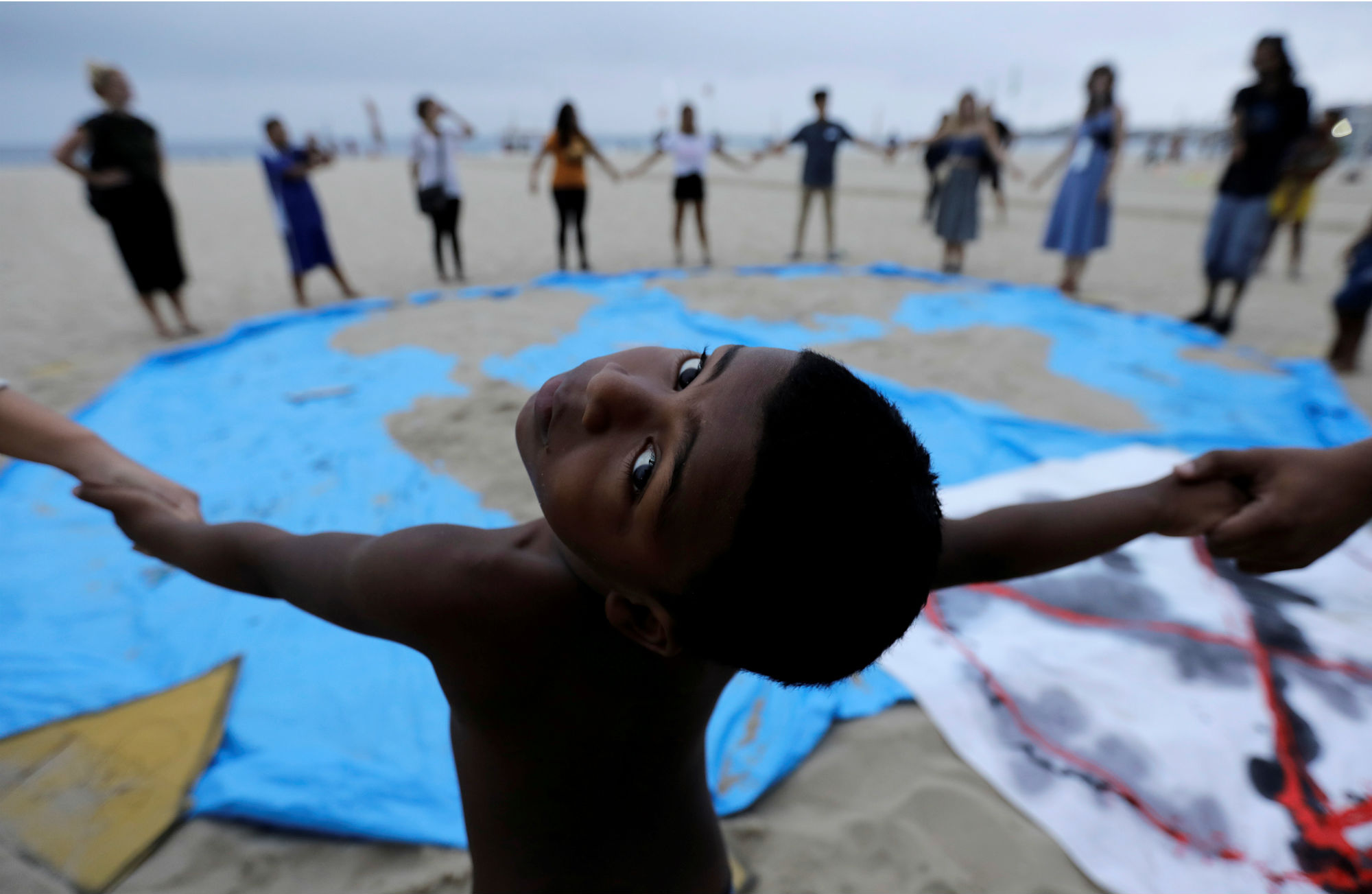 A child and climate change activists attend the Extinction Rebellion protests on Copacabana beach in Rio de Janeiro, Brazil on October 7, 2019. REUTERS/Sergio Moraes