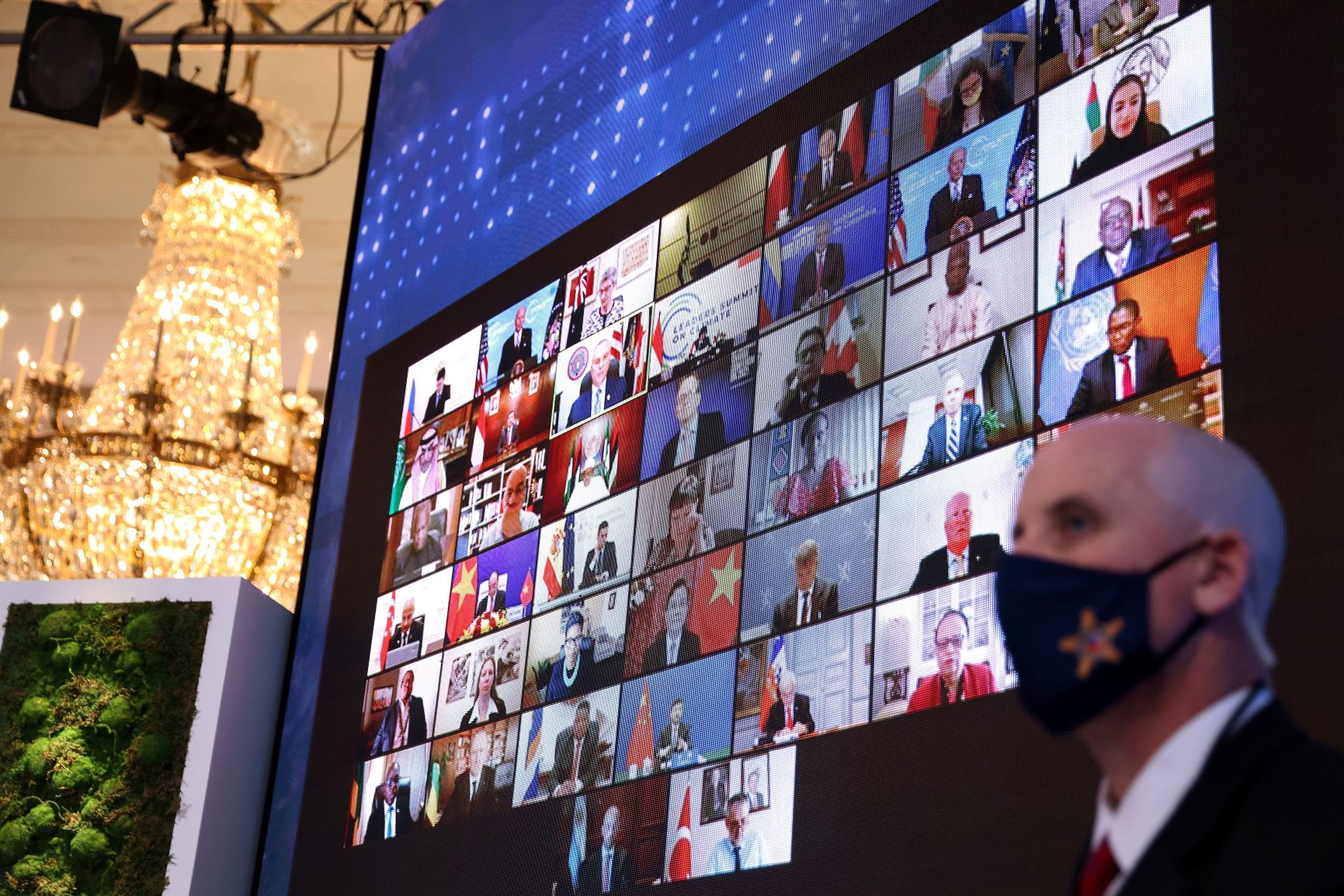 World leaders appear on a video screen during a virtual Climate Summit with world leaders in the East Room at the White House in Washington, DC, on April 23, 2021. REUTERS/Tom Brenner