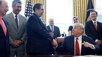 Trump hands pen to president of the United Steelworkers