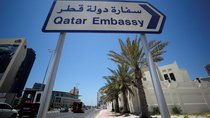A sign indicating a route to Qatar embassy in Bahrain