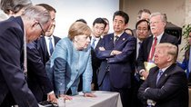 German Chancellor Angela Merkel speaks to U.S. President Donald J. Trump during the second day of the G7 meeting in Charlevoix, Canada on June 9, 2018.