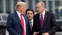 U.S. President Donald Trump and Turkish President Tayyip Erdogan gesture as they talk at the start of the NATO summit in Brussels, Belgium on July 11, 2018.
