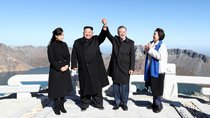 South Korean President Moon Jae-in and North Korean leader Kim Jong-un pose for photographs on the top of Mt. Paektu, North Korea.