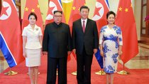 North Korean leader Kim Jong Un and his wife Ri Sol Ju pose beside Chinese President Xi Jinping and his wife Peng Liyuan in Beijing, China.