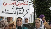 "Women from various regions of Morocco protest against violence towards women, in Rabat. The placard reads, ""Stopping harassment gives dignity for women."""