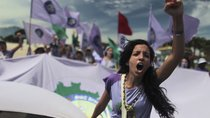 A woman protests violence against women, at the close of the National Meeting of Rural Women, in Brasilia February 21, 2013.