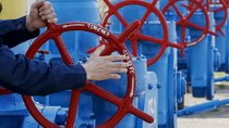 An employee turns a valve at a gas compressor station in the village of Boyarka, outside Kiev, April 22, 2015