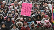 Participants listen to speakers outside City Hall during the Women's March in Toronto.