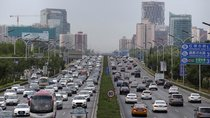 Cars drive on the road during the morning rush hour in Beijing, China, July 2, 2019.
