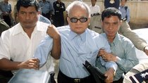 "The Khmer Rouge's most senior surviving leader, ""Brother Number Two"" Nuon Chea, is held as he approaches the municipal court in the Cambodian capital Phnom Penh on December 13, 2002."