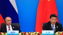 China's President Xi Jinping and Russia's President Vladimir Putin attend a signing ceremony during Shanghai Cooperation Organization (SCO) summit in Qingdao, Shandong Province, China on June 10, 2018.