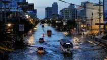 The main avenue of northern Bangkok are transformed as rivers.
