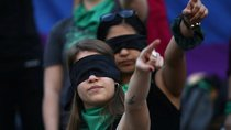 Women during a demonstration against gender violence at Angel de la Independencia monument in Mexico City, Mexico.