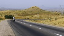 A man rides his motorbike along Gombe Numan highway in Gombe state, on November 29, 2013.