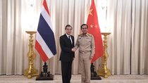 Chinese Foreign Minister Wang Yi (L) shakes hands with Thai Prime Minister Prayuth Chan-ocha (R) at Government House in Bangkok, Thailand on July 24, 2017.