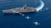 Aircraft fly from the aircraft carrier USS Ronald Reagan in the Indo-Pacific