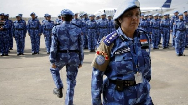 The first all-female unit of UN peacekeepers stand at attention as they arrive outside Liberia's capital, Monrovia, on January 30, 2007. Christopher Herwig/Reuters