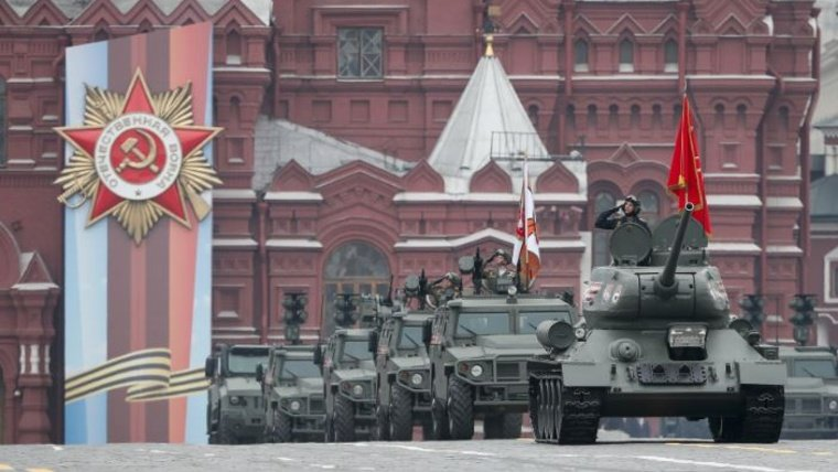 Russian servicemen drive a T-34 Soviet-made tank, Tigr-M (Tiger) all-terrain infantry mobility vehicles equipped with Arbalet weapon modules and Tigr-M (Tiger) all-terrain infantry mobility vehicles equipped with Kornet-D1 anti-tank guided missile systems during the Victory Day parade, which marks the anniversary of the victory over Nazi Germany in World War Two, in Red Square in central Moscow, Russia May 9, 2019. REUTERS/Shamil Zhumatov